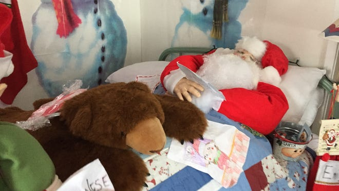 Santa Claus naps at the Cozy Cabins in Burtchville Township.