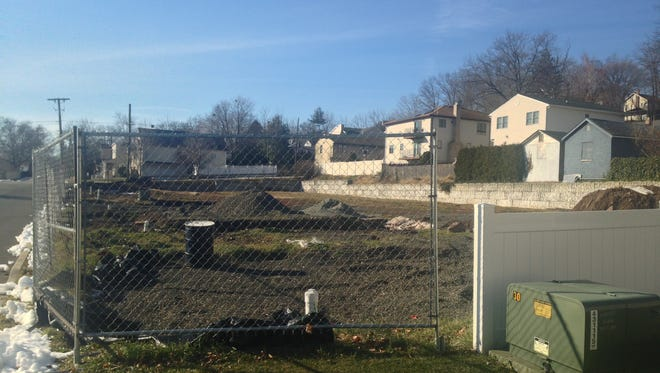 The half acre lot at the corner of Washington Place and Oldfield Avenue may become home to a 10-unit housing complex, once environmental cleanup is complete, and if the zoning board approves variances.