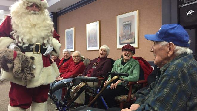 Santa greets Botsford Commons resident Fritz Putkela, who celebrated his 100th birthday Christmas Eve.
