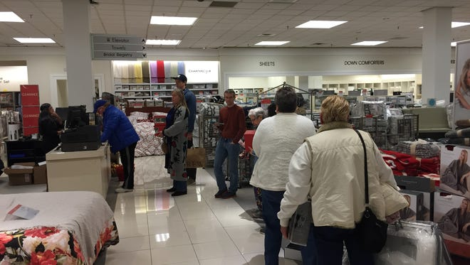 Customers wait to make their purchases on Dec. 26, 2016 at the Rockaway Townsquare mall Macy's.