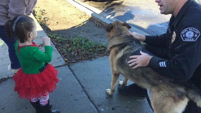 "Simi Valley K-9 Officer Jason Wilkinson and his partner Titan visited a Simi Valley girl whose favorite Christmas decoration was vandalized. Officer Kristen Mesa launched a fundraiser to replace the ""Paw Patrol"" inflatable."