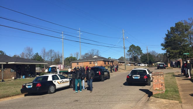 A teenage boy and a man were shot and killed in the 100 block of Longbrook Drive on Friday morning.