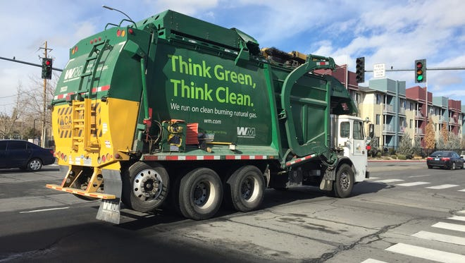 A Waste Management garbage truck heads for the Reno transfer station.
