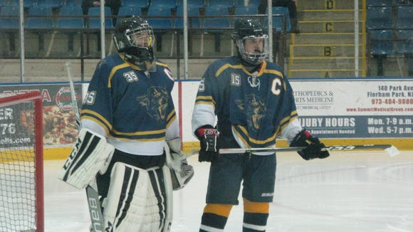 Pequannock winger Andrew Sontag (15), shown with goalie Dylan Knighton during their team's Jan. 4 hockey game versus Morris Catholic/DePaul, ranks fourth in North Jersey with 33 points.