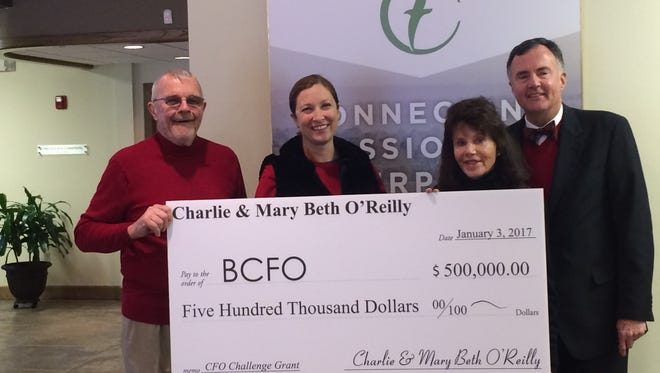"Charlie and Mary Beth O'Reilly donated $500,000 to the Breast Cancer Foundation of the Ozarks to be used as a ""challenge grant."" Pictured from left are Charlie O'Reilly (BCFO trustee), Crystal Webster (BCFO executive director), Mary Beth O'Reilly (BCFO founder) and Brian Fogle (Community Foundation of the Ozarks president)."