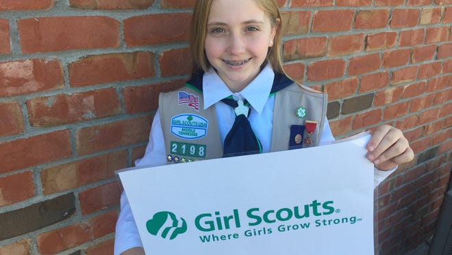 Elizabeth Anderson was awarded a Girl Scout honor for saving her sister's life recently.