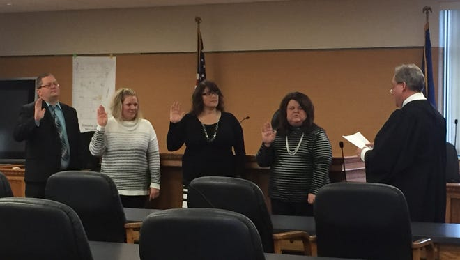 The following recently elected Kewaunee County officials were sworn in Tuesday by Kewaunee County Circuit Court Judge Keith A. Mehn (right): District Attorney Andrew Naze (left), County Clerk Jamie Annoye, Treasurer Michelle Dax, and  Register of Deeds Germaine Bertrand,