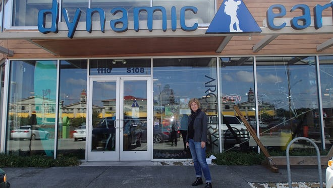 Backwoods CEO Jennifer Mull stands outside the Dynamic Earth store in Springfield in 2014.
