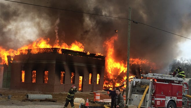 Knoxville Fire Department firefighters battle a raging fire at a construction site in Bearden on Thursday, Jan. 5, 2017.