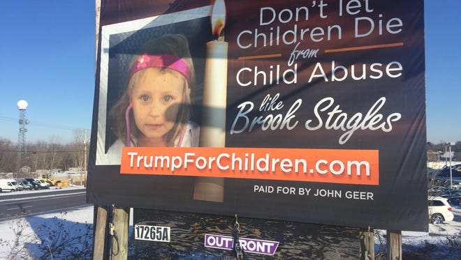 A billboard in Henrietta advertises Irondequoit grandfather John Geer's campaign to bring reform to child protective services.