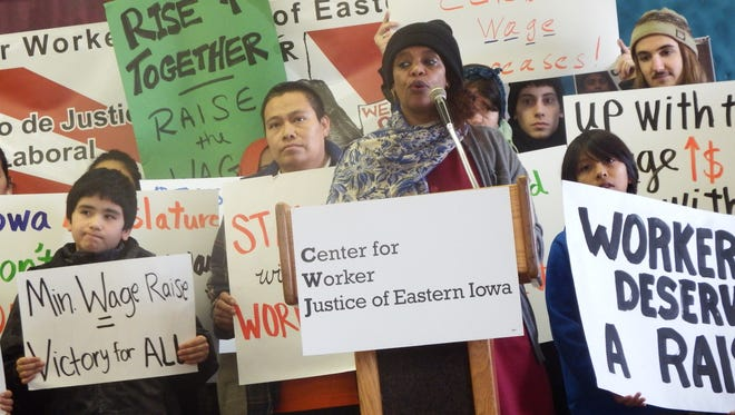 Mazahir Salih, president of the Center for Worker Justice of Eastern Iowa, speaks in front of minimum wage supporters at the center's Iowa City headquarters on Jan. 7, 2017.
