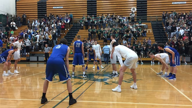 West Salem and McNary players prepare for the opening tip at West Salem High School. West Salem prevailed 56-47 at home on Jan. 6, 2017.