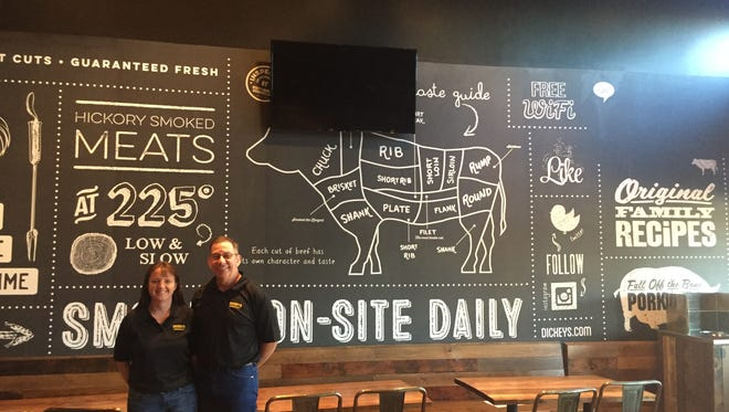 Keith and Tamara Willis stand in the dining room of their new Dickeys franchise in Ruidoso Downs.