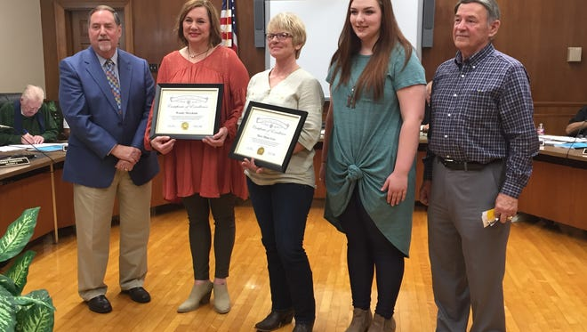 Ouachita Parish Schools Superintendent Don Coker (left) and Transportation Director Skeeter Boyd (right) commended Wendy Merchant, Diane Gray and Hope Merchant on their actions helping a family injured in a hit and run in December and caring for the children on the school bus who witnessed the accident. They were honored Thursday at the Ouachita Parish School Board meeting.