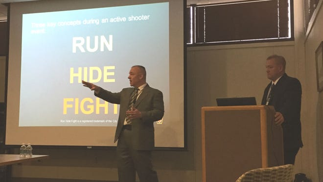 Pennsylvania State Police Cpl. Jack Stchur, left, and Lt. John Yunk gave a presentation Thursday at the York Daily Record offices about how to be prepared for active shooter situations.