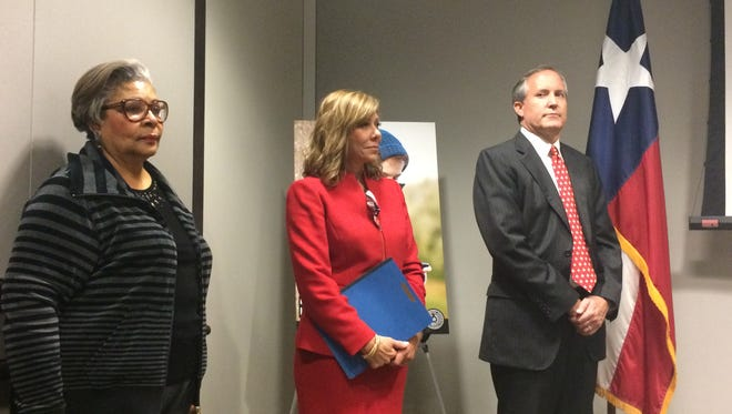 State Rep. Senfronia Thompson (left) with state Sen. Joan Hoffman and Attorney General Ken Paxton talk about combatting human trafficking on Jan. 12, 2017, in Austin.