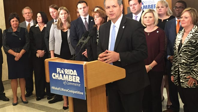 State lawmakers and business leaders stand behind Florida Chamber CEO Mark Wilson when he released the group's 2017 legislative priorities.