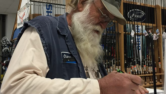 Clarence Voss registers for the 2017 Times All-City Championship Saturday at the Bayou Outdoor store in Bossier City. Voss once wrestled a bear in a bar.
