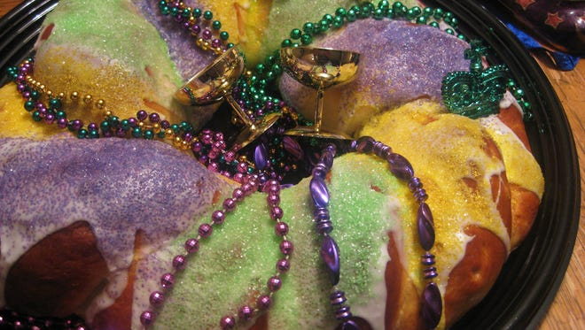 3) Icing on King Cakes is drizzled in three colors: purple for royalty, green for justice and gold for power.