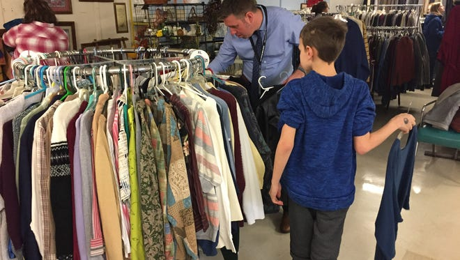 R.J. Long, an assistant principal at Emory H. Markle Intermediate School, joins middle school students in volunteering to sort donated clothing at the Hanover Area Council of Churches Monday. The volunteer work was part of a district-wide initiative to spend Martin Luther King Jr. Day in service to others.