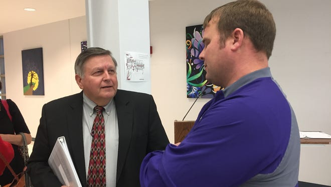 Logansport coach Kevin Magee (right) visits with LHSAA's Keith Alexander during Tuesday's meeting in Bossier City.