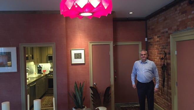 Developer Tim Tompkins at his new transformed living space downtown.
