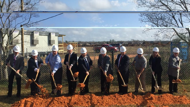 Local officials break ground at a new elementary school on Kingsfield Road earlier this year.