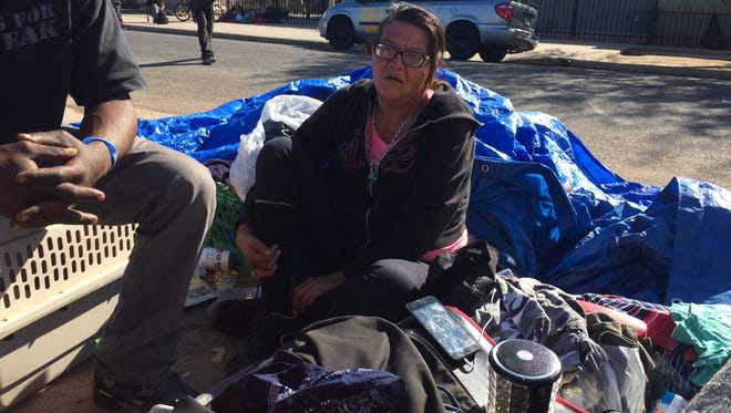 Monica Martinez camps outside a homeless shelter that must remain half empty
