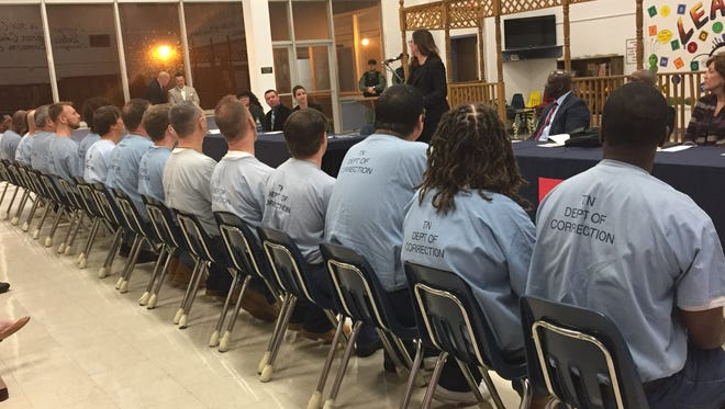 Julie Doochin, executive director of the Tennessee Higher Education Initiative, center, speaks to the class of graduates Thursday. Assistant Commissioner of Prisons Bobby Straughter sits at right.