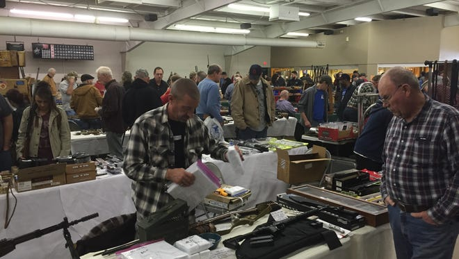People packed the Richland County Fairgrounds for the Heritage Arms gun show on Saturday.