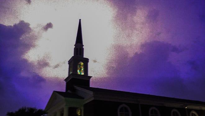 Lighting lights up the night sky near Club Zion church in Cocoa Beach.