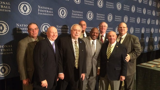 Bill Farkas with College Hall of Famer Archie Griffin and his entire board of directors.