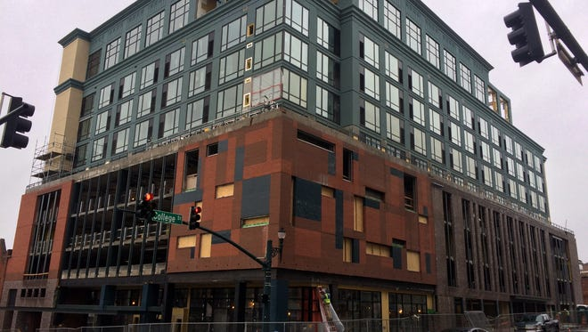 "The AC Hotel in downtown Asheville, at the corner of College Street and Broadway, is nearing completion. Workers applying an exterior material caused a ""snowstorm"" of white pellets to hit the streets below last week."