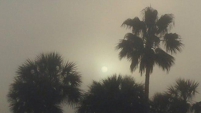 The sun rises behind dense fog on Wednesday morning.
