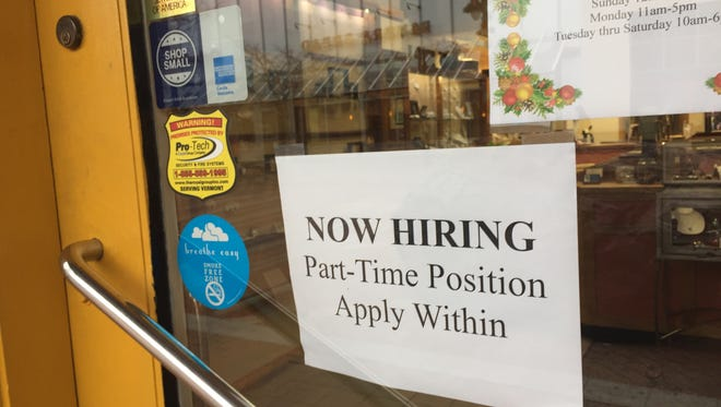 A help wanted sign hangs on a store on Church Street in Burlington in December 2016.  The latest report from the Vermont Department of Labor showed that Vermont continues to have a very low unemployment rate.At 3.2 percent, Vermont's June 2017 rate was well below the national average of 4.4 percent.
