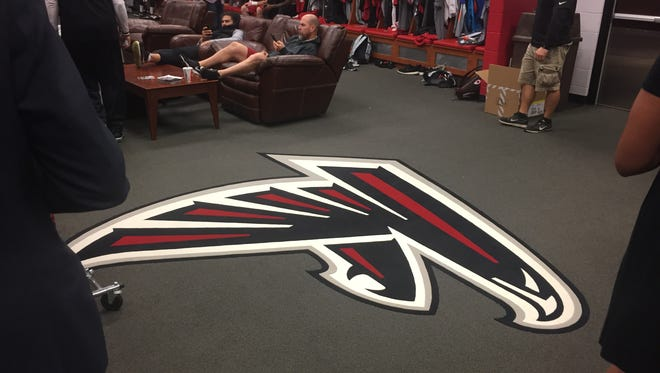 The logo in the Falcons' locker room is not to be stepped on.