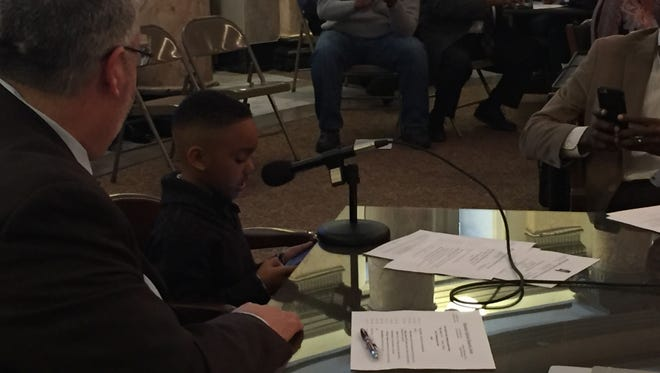 Kayden Johnson, 8, speaks before a joint meeting of House and Senate Democratic and Legislative Black Caucuses Friday.