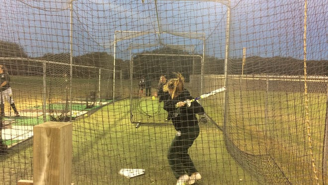 Rockport-Fulton coach Melissa Reyes throws batting practice during a morning workout on Friday, Jan. 27 at the Rockport-Fulton High School softball field.