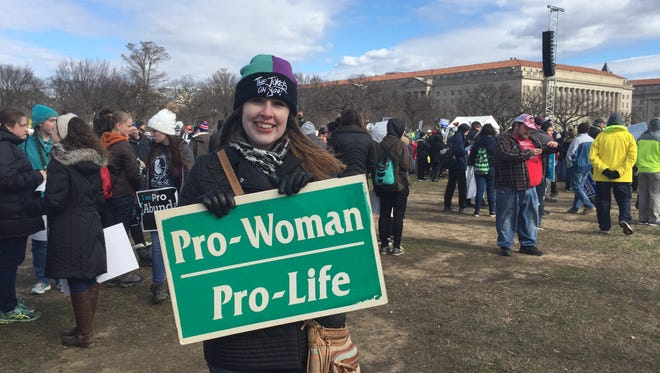 "Anna Geer shows off her sign at the March for Life in Washington, D.C. Jan. 27, 2016. Geer said that she didn't think the Women's March was ""very inclusive."""