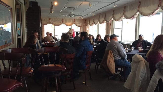 Community members eat breakfast at the Buckeye Lake Yacht Club during the third annual Winterfest.