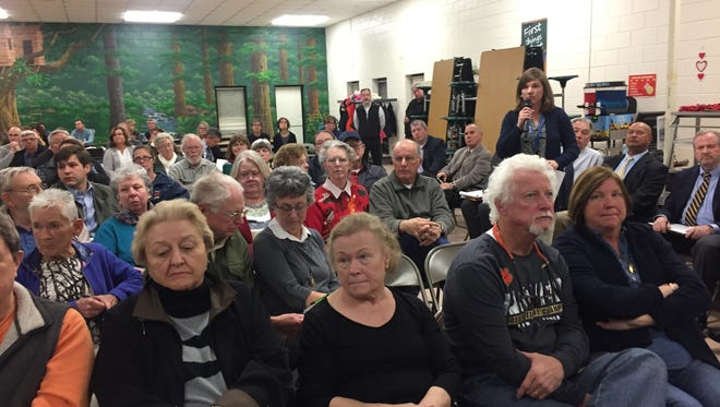 Nearly 100 residents packed into the Cedar Grove Elementary cafeteria to ask health department officials questions about the cleanup of the 2014 Kinder Morgan gas spill near Belton.