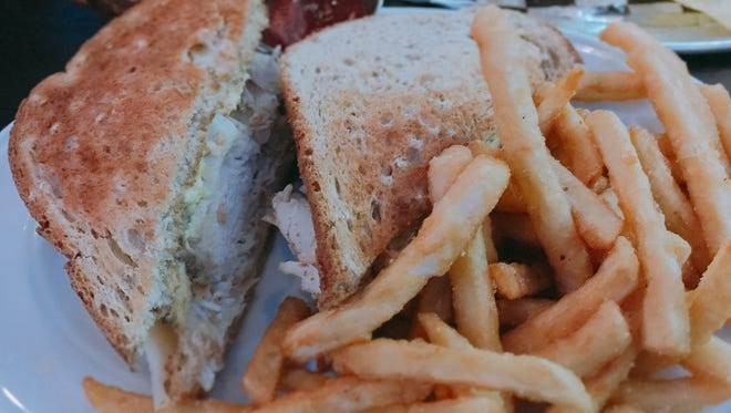 The roasted turkey sandwich includes avocado, coleslaw, Havarti and Russian dressing. They are served with excellent French fries.