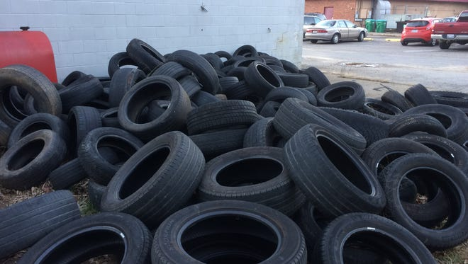 The Midas car repair store at 162 Tunnel Road left dozens of old tires behind the shop after closing recently.