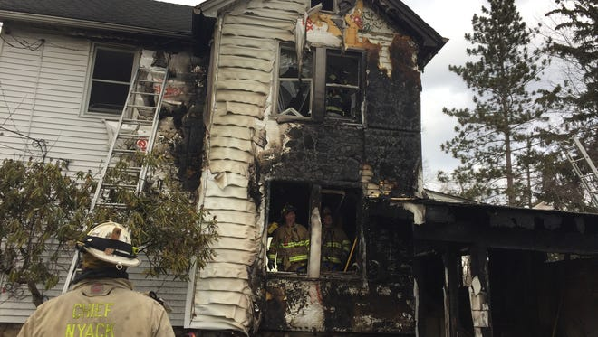 The charred remains at a North Williams Street house in Pearl River after flames rose from the first floor to the third floor on Feb. 1