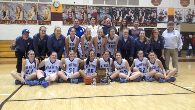 The Memorial Tigers pose with the sectional trophy after defeating Heritage Hills, 55-40.