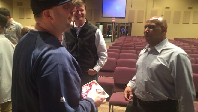 Terry Pendleton talks with fans after speaking at Chapel Hill Baptist Church on Saturday. He is now the bench coach for the Atlanta Braves.