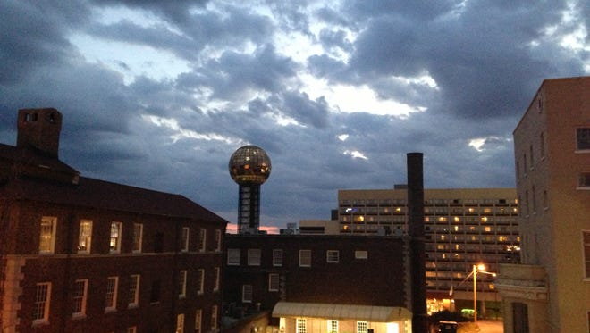 Clouds form over the YMCA and Sunsphere in downtown Knoxville on March 16, 2013.