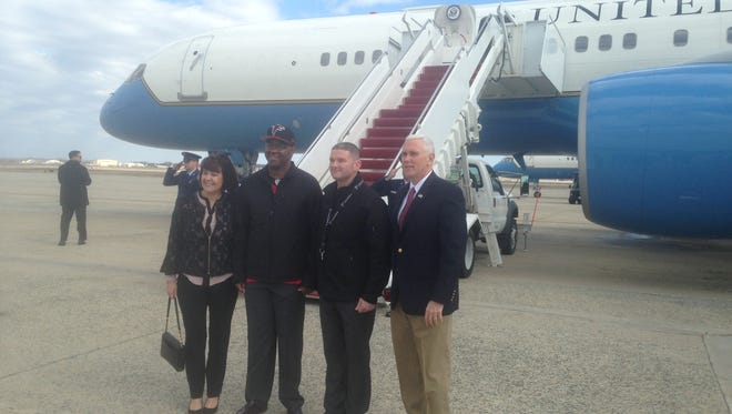 Vice President Mike Pence and his wife, Karen, pose in front of Air Force II with Army Staff Sgt. Frederick Manning and Army Sgt. First Class Charles Stanley, before flying to Houston for the  Super Bowl, Feb. 5, 2017.