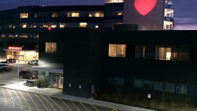 Mercy Health-West Hospital flashes a heart at night during February.