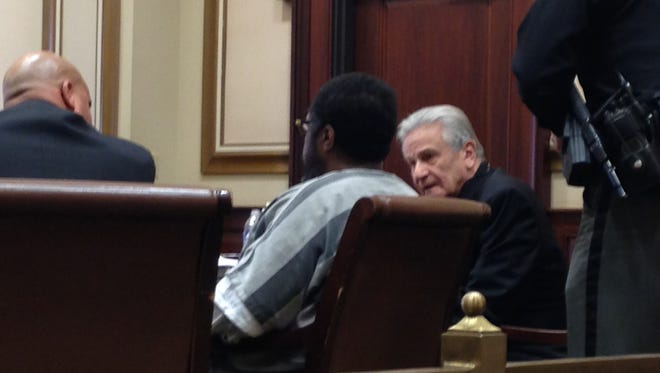 Howard Martin, seated between his attorneys Perry Ancona, at right, and Bernard Mundy in Hamilton County Common Pleas Court Monday.